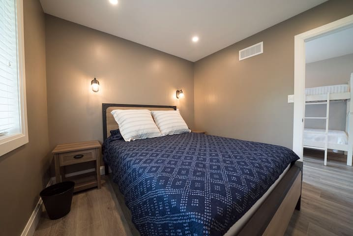 Each of the bedrooms has a queen sized bed and closet.   *please note linens and comforters not provided. Pillows are provided.