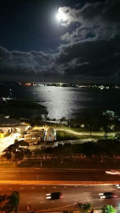 unit balcony night view with full moon shimmering on the Broadwater