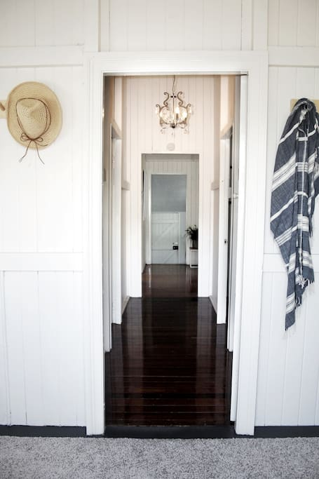 Entrance way with high ceilings and original hardwood floor.