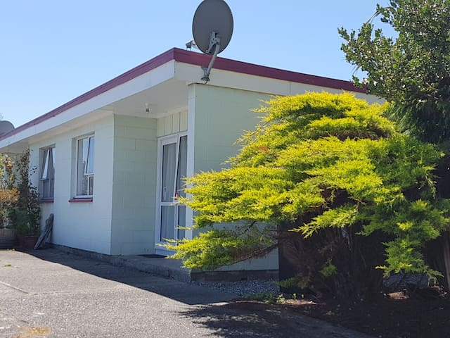 Self contained unit with laundry in Westport CBD