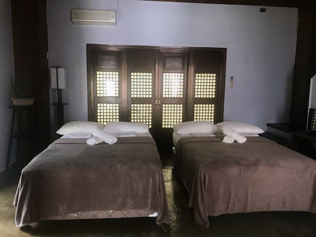 Master Suite - pair of double beds in bedroom