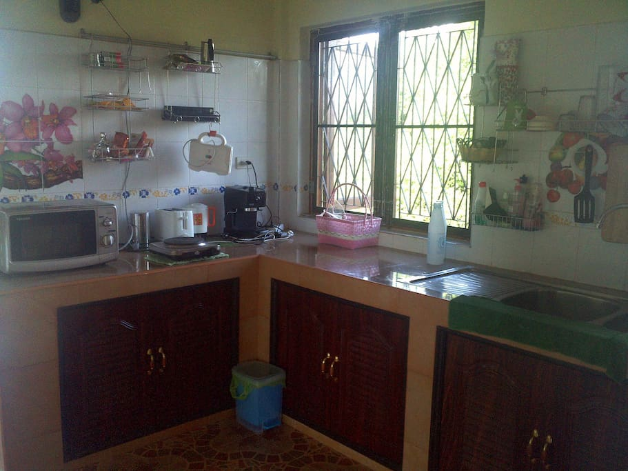 kitchen with microwave, refrigerator, stoves(electric and gas), toaster, kettle, Nespresso machine.