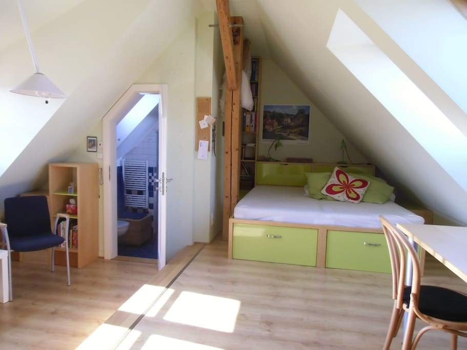 the attic romm with connected bathroom
