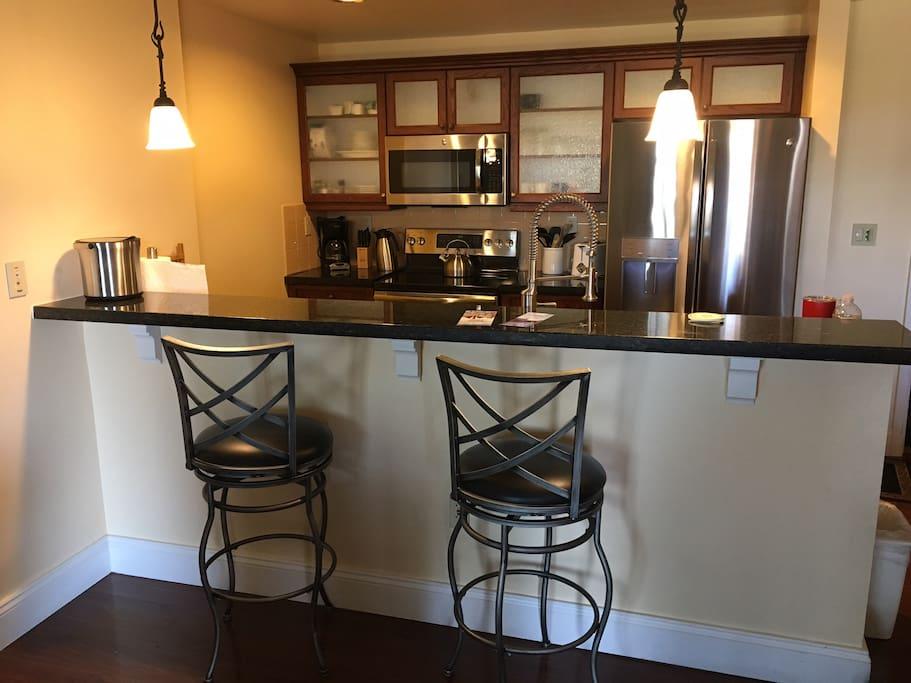 Convenient breakfast bar in open concept great room.