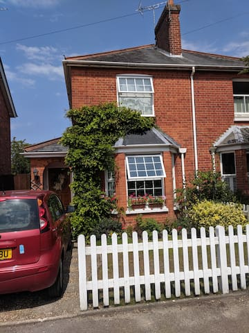 The house is a Victorian semi, centrally located in a Surrey village, with plenty of free parking on this quiet residential road.