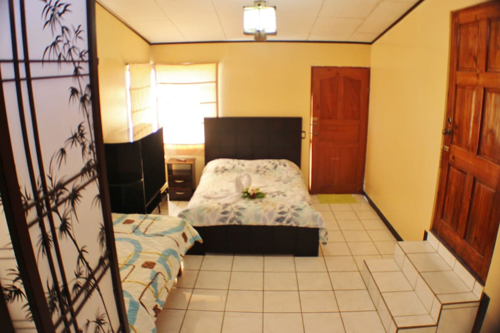 The Ensuite has one double bed and one single bed. This room has it's own entrance, private bedroom and bathroom.