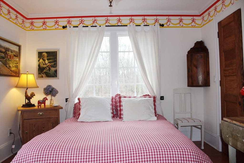 The Red Room. Queen size bed and closet. Shared bathroom located outside this room.