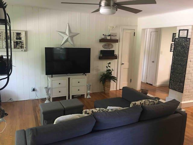 Open floor plan, living room with Big screen TV, sofa bed