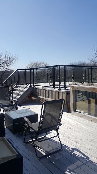 North facing deck with patio furniture and sun deck. Downstairs gazebo should be finished by summer 2018.