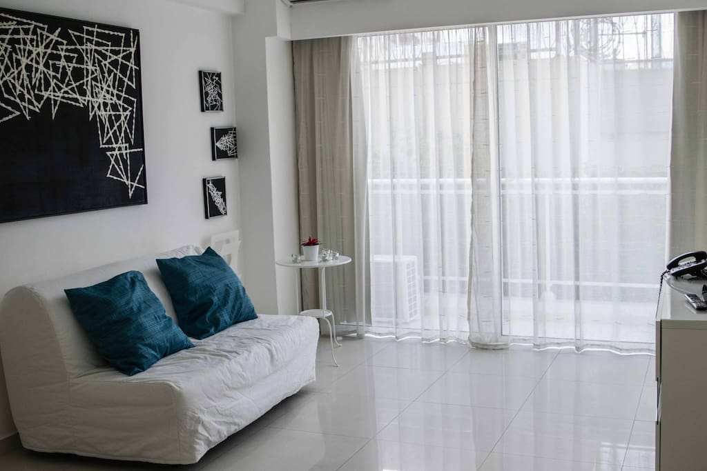living room equipped with an additional and very comfortable bed sofa