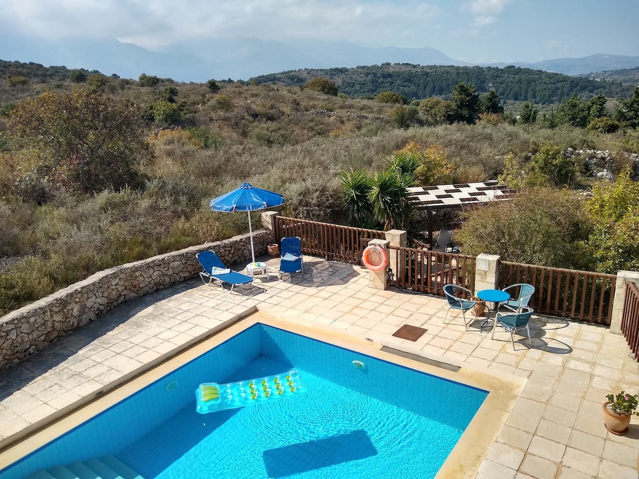 View from villa balcony across the pool to the White Mountains. The shady pergola can be seen in the garden.