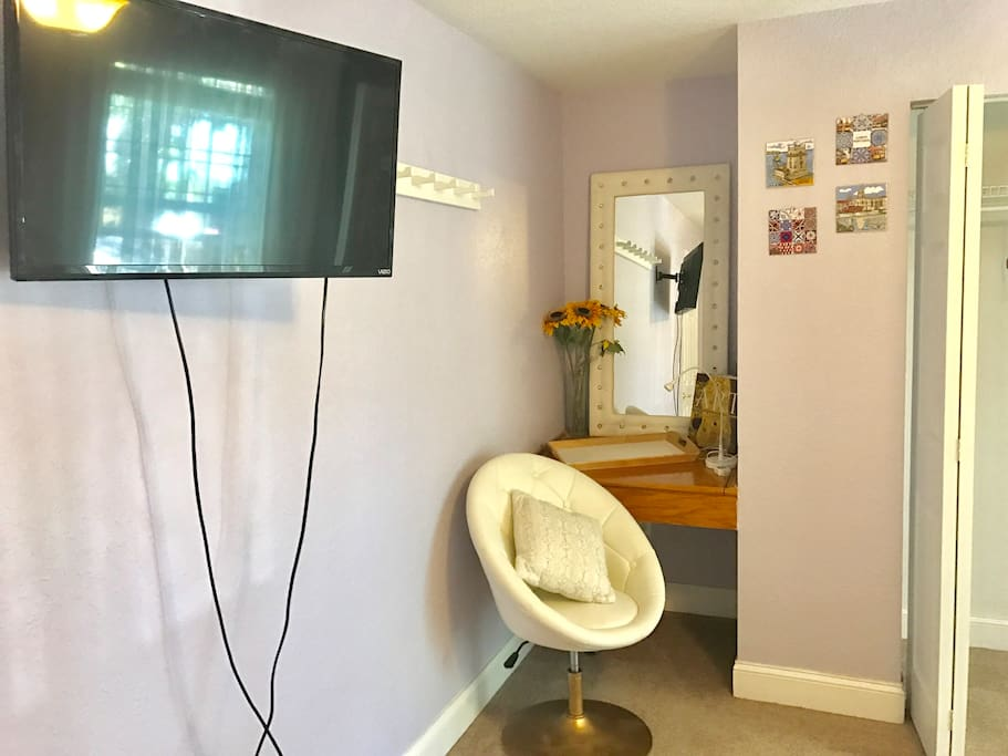 Smart tv with set up Netflix and laptop friendly area in your private bedroom