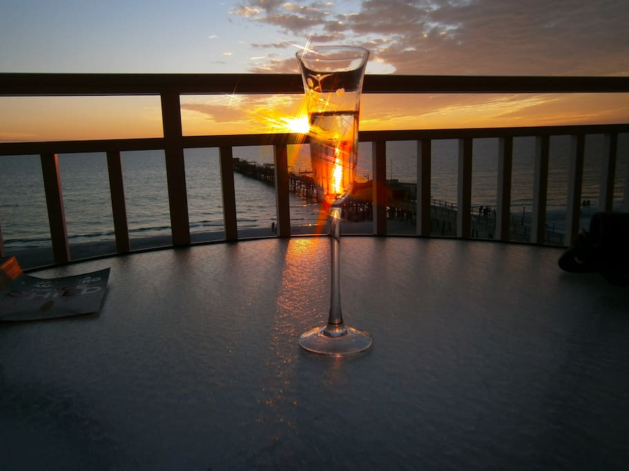 A Sunset drink on our beach front private balcony