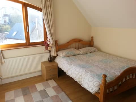 Large double bedroom with beautiful view of Collooney church.