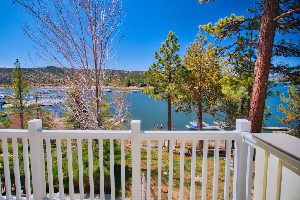 The master bedroom has a private balcony overlooking the lake, with easy access to the patio below.