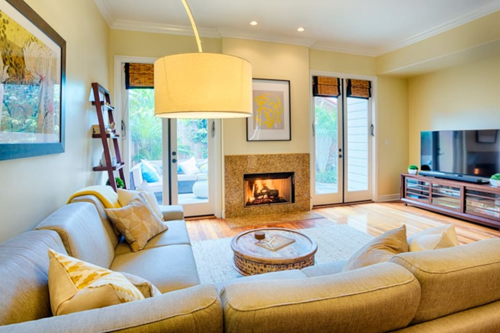 Comfortable living area with gas fireplace and  large flat screen TV.
