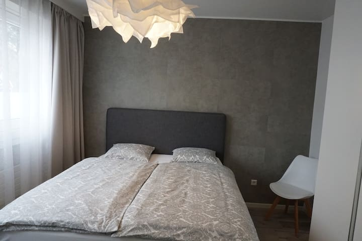 1st sleeping room with boxspringbed, excellent sleeping comfort
