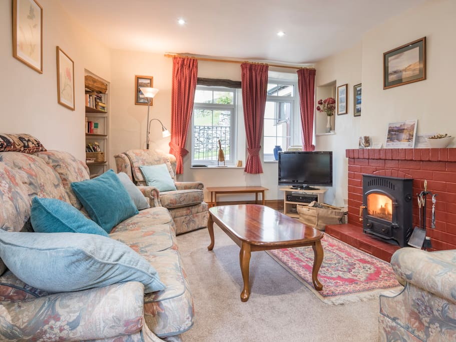 Snug sitting room with log burner, tv/dvd, books, games, maps. There is also good wifi throughout the cottage.