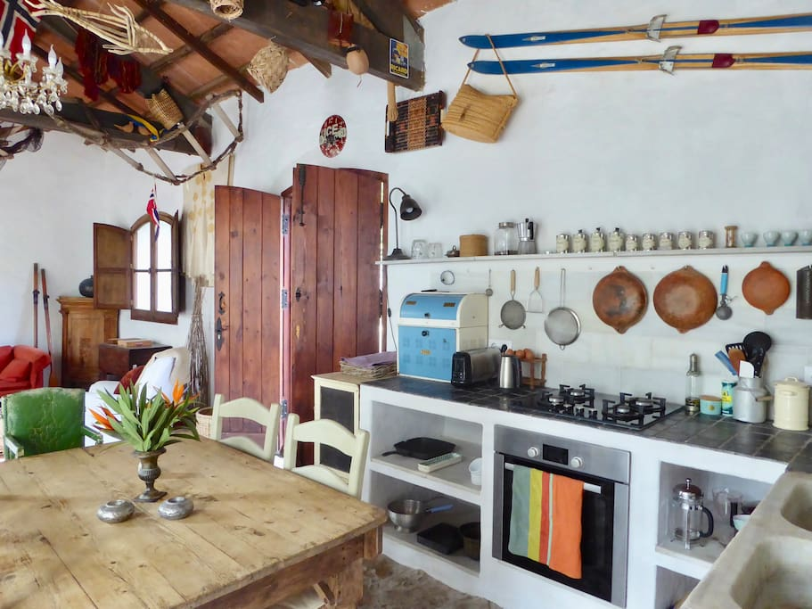Large open plan kitchen / sitting room opening onto bouganvillea-filled courtyard