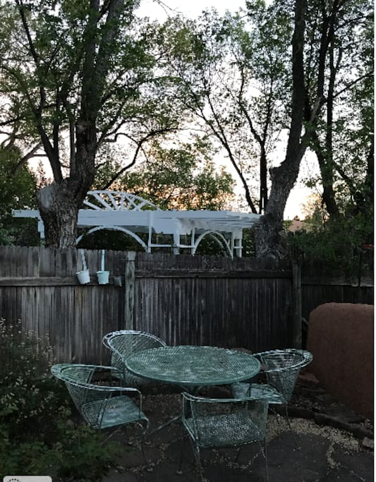 400 soft private patio faces south. Beyond the fence is open land and walking trails.