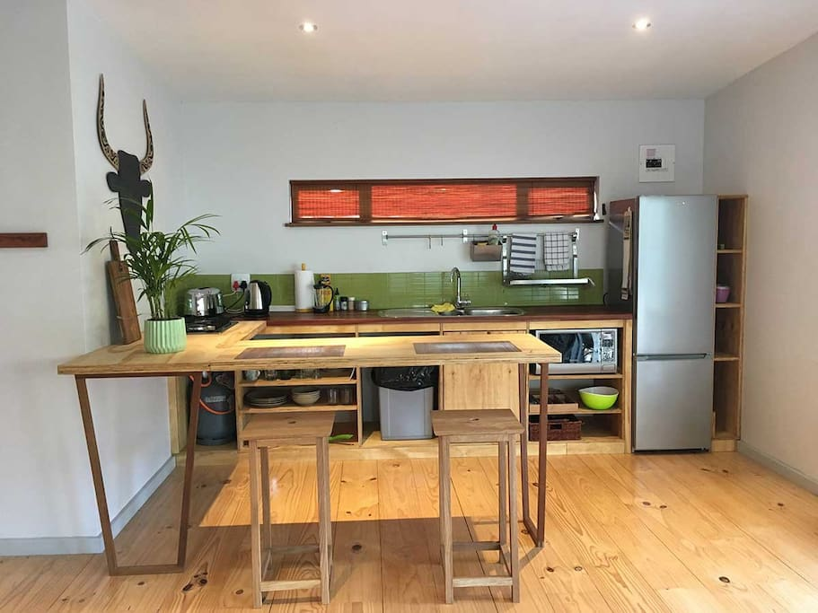 hand crafted wooden kitchen, teak counter, modern accessories