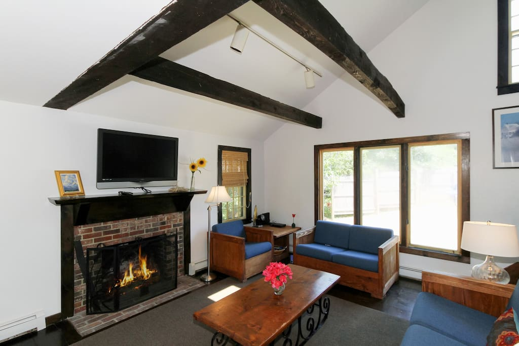 Beamed ceilings and original hardwoods add character to the living area.
