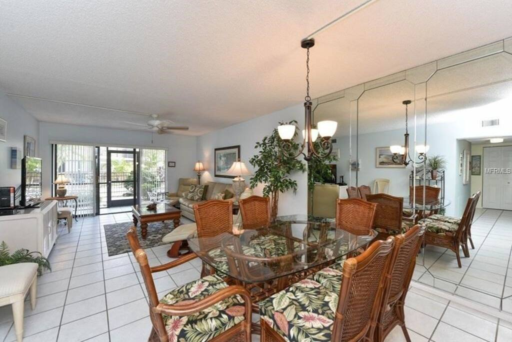Dining Room and Living Room lead to porch and pool.