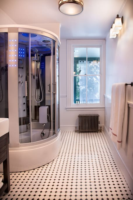 The Inventor's Suite bathroom features edison lighting from the past and a spa shower with steam for the future.