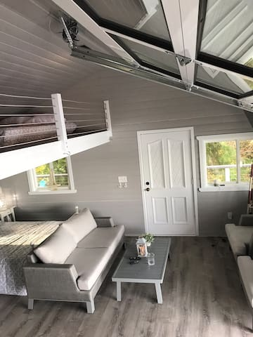 Loft, high ceilings, insulated floor to ceiling motorized garage door on beach side