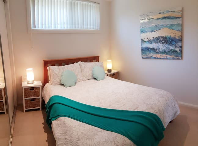 Cosy bedroom with double bed and large wardrobe and smart tv