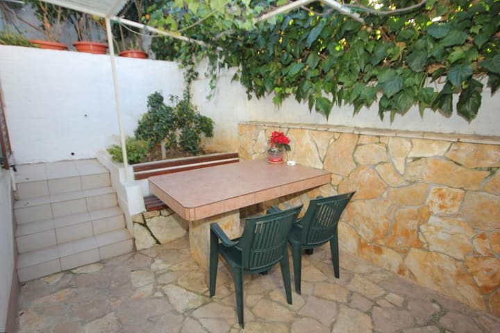 One bedroom apartment with terrace Seget Vranjica (Trogir) (A-8623-b)