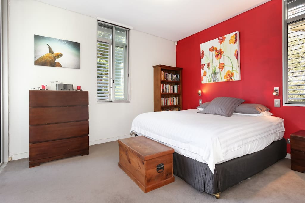 Master bedroom with view of the City, an ensuite and a door to close off from main living area