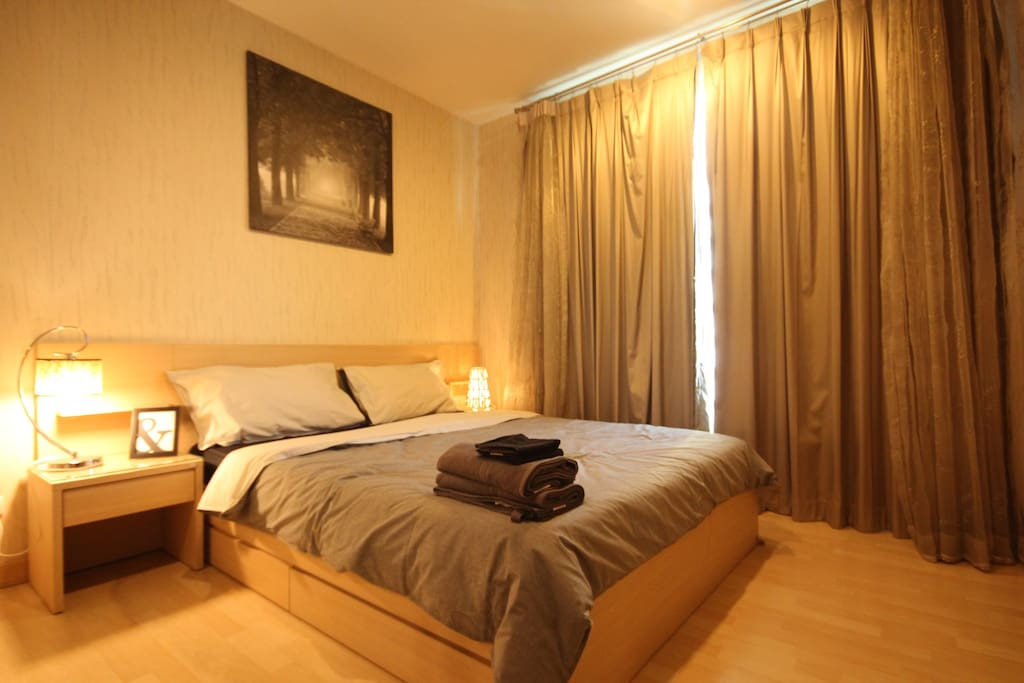 The cozy bedroom with an air conditioner & 100% UV curtain.