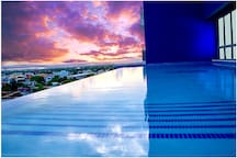 Premium amenities included: Infiniti pool, gym, rooftop deck, elevator, top-notch security