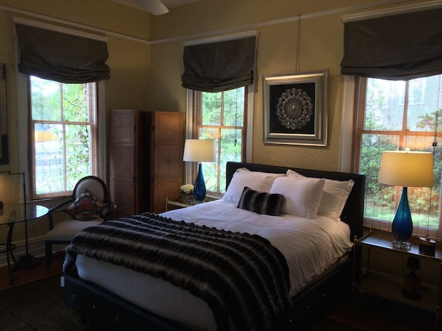 Large sun filled bedroom with new queen sized bed.