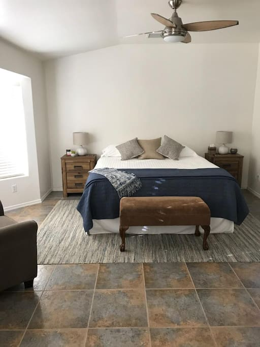 Master Bedroom with VERY COMFY king bed, ceiling fan, USB ports on nightstands