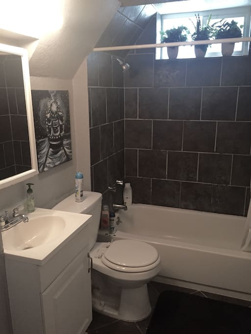 Nice clean bathroom with a tub for relaxing baths!