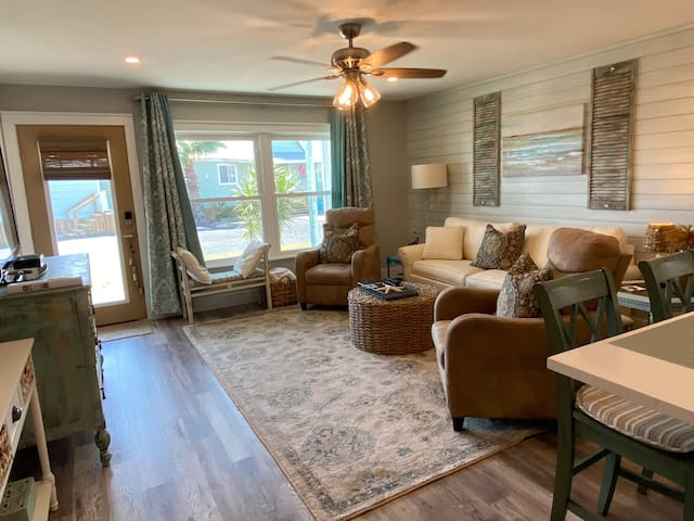 Gorgeous, comfortable & coastal themed living room decor. Features an Ethan Allen queen pull out sofa bed with a very comfortable mattress & the chairs are recliners.