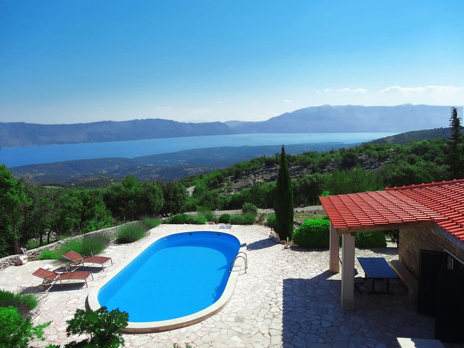 Sea view, garden view, pool view and mountain view. Small bay directly under pool on photo is small town Pucisca, 6 km away.