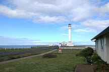 View from the front driveway area of the Keeper's Apartment towards the Lighthouse.