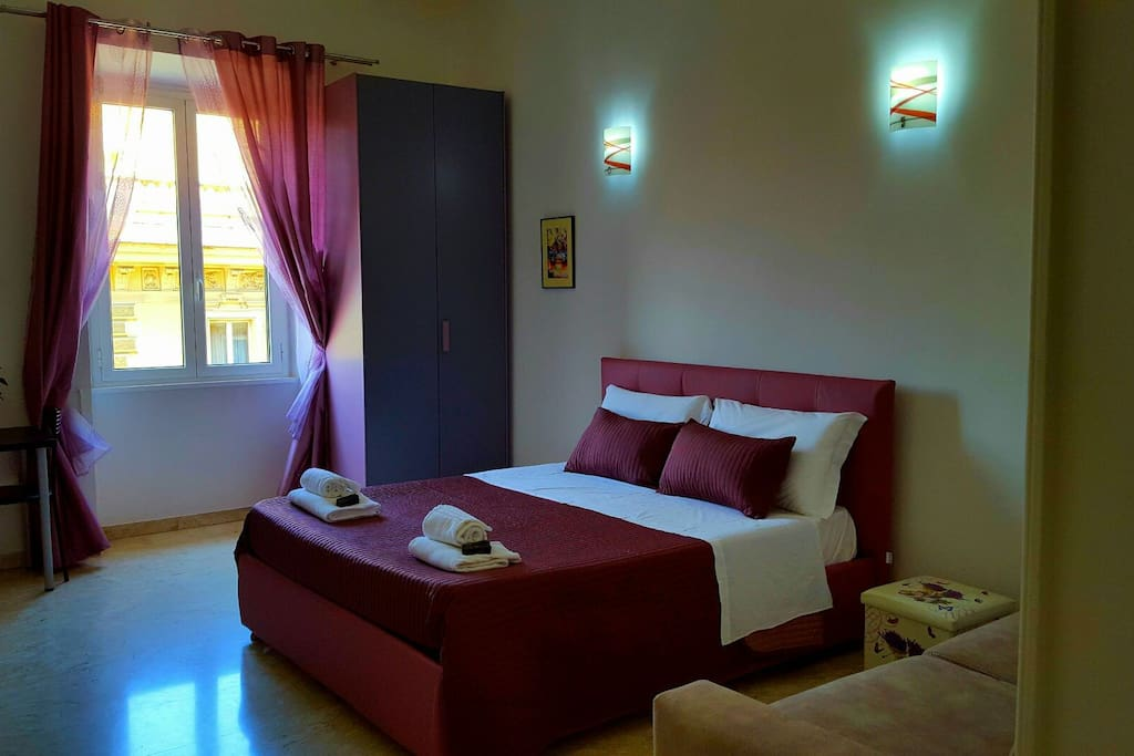 "Room ""Violet"" with double king size bed, double sofa bed, TV, closet and desk"