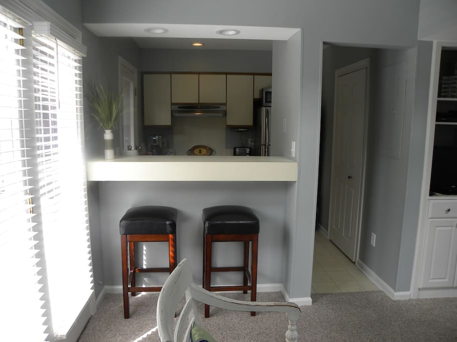 Small but fully equipped kitchen with washer/dryer in closet to the right.