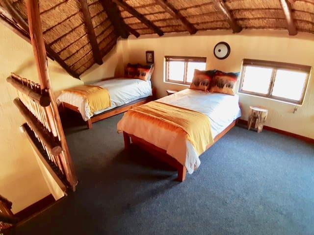 Loft room en -suite with bath. Two single beds