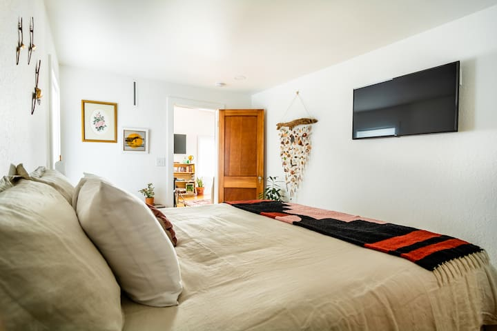 King size pillow top bed with Egyptian cotton sheets and linen bed coverings. In room TV with Netflix.