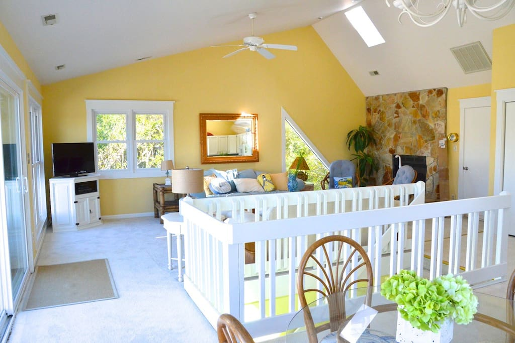 Open floor plan with the sun streaming through all the beautiful new windows!