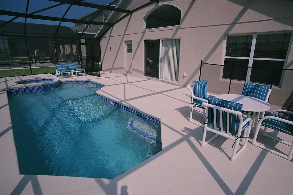 Our pool deck with attached spa
