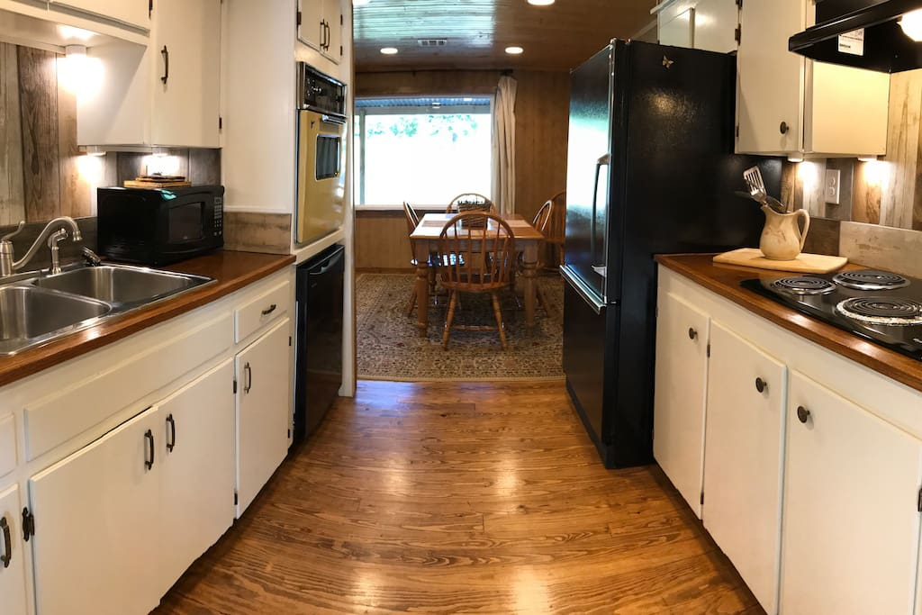 Galley kitchen is fully appointed. The dining table seats 6.