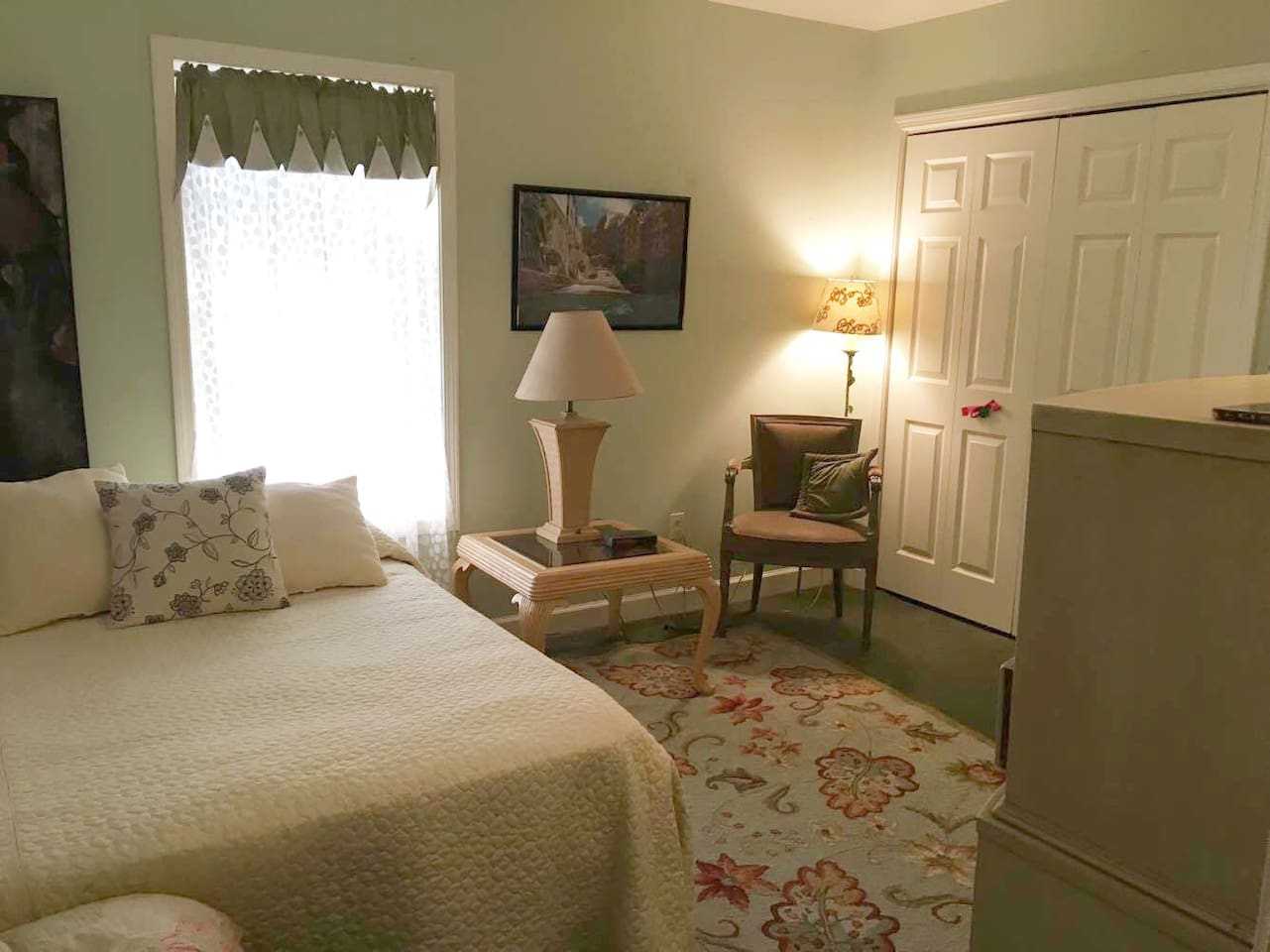 Private comfortable bedroom with a queen size bed.
