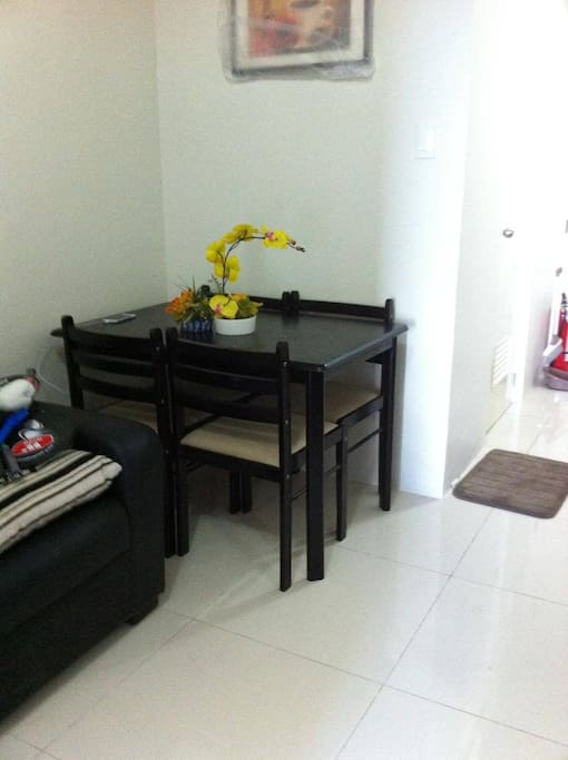 This unit is a fully-furnished condo with 1 queen-sized bed, 2 sofa beds, flat screen TV with digibox, refrigerator, other basic kitchen utensils, and shower heater in the bathroom.