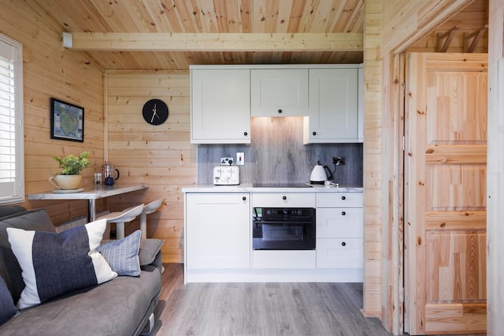 Open Plan Lounge with Kitchenette and Dining Area.